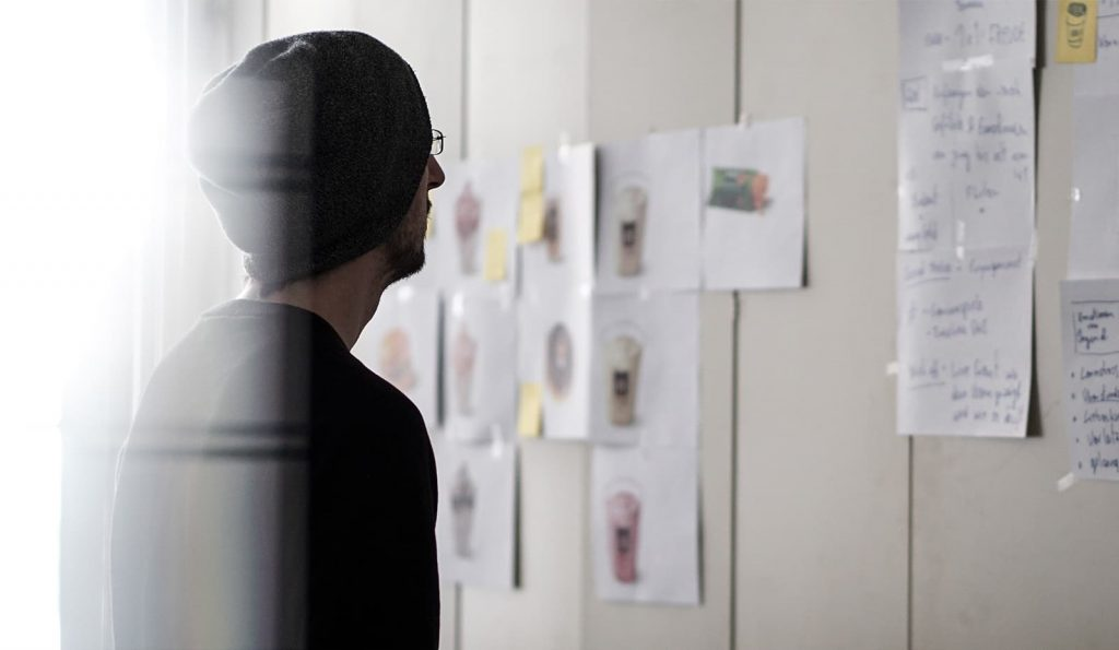 Digital marketer brainstorming on a whiteboard