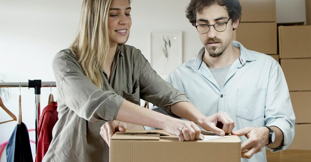 seller couple packing purchased product online sales